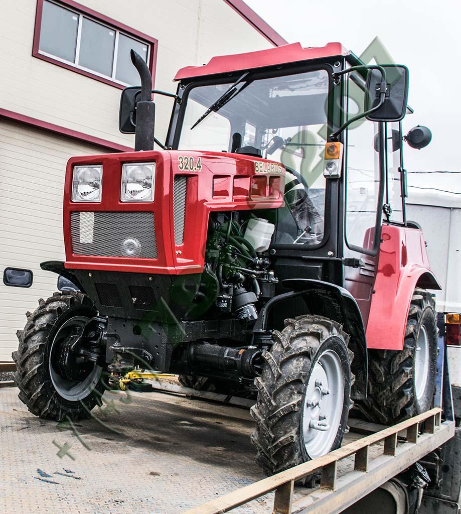 Трактор беларус 320.4 на эвакуаторе